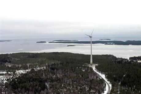 Single Wind turbine in front of ocean
